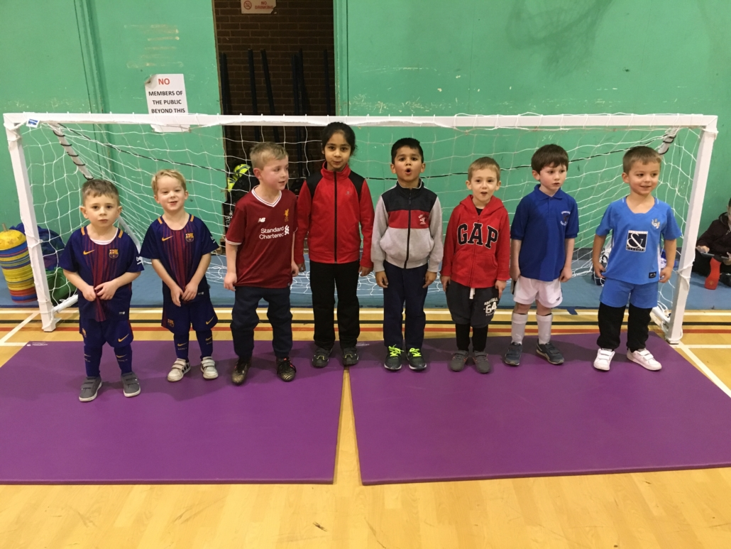 Young footballers at indoor mini soccer