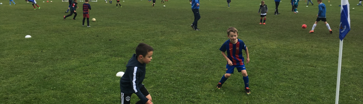 Children learning to play football at Bedworth Eagles mini soccer
