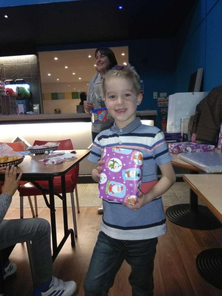 U7s player receiving his bowling raffle prize