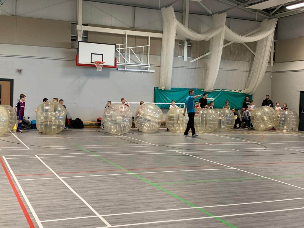 Players ready for the zorbing warmup whilst parents look on