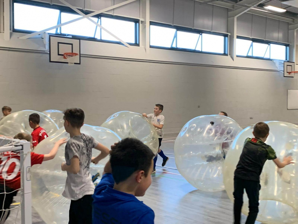 Players rolling the zorbs around