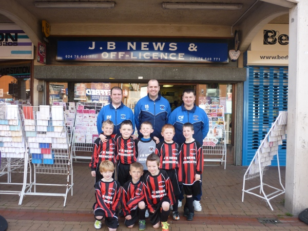 Young football team outside of sponsor shop