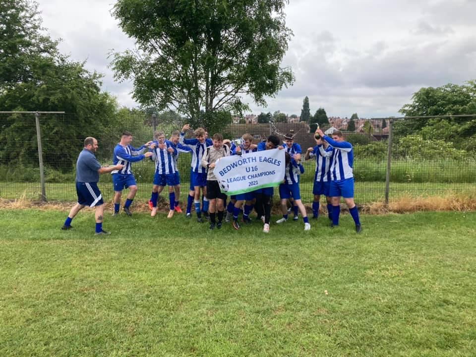 Eagles U16s celebrating holding banner